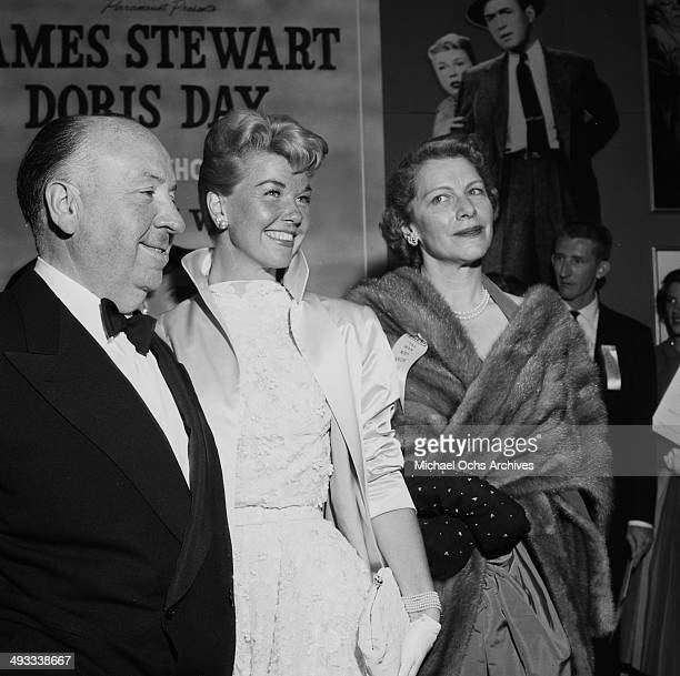 Director Alfred Hitchcock with actor Jimmy Stewart and actress Doris Day at the premier of 'The Man Who Knew Too Much' in Los Angeles California