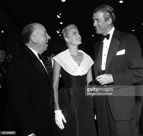 Director Alfred Hitchcock with actress Grace Kelly and actor Jimmy Stewart at the premier of Rear Window in Los Angeles California