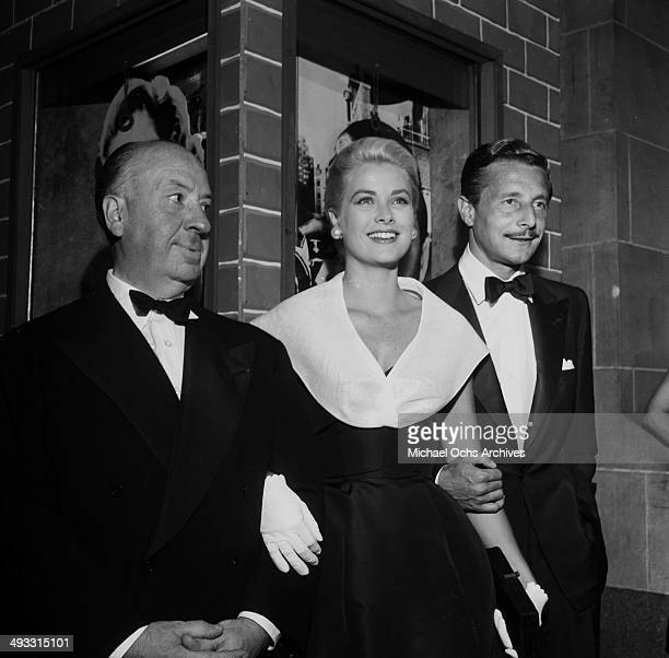 Director Alfred Hitchcock with actress Grace Kelly and Oleg Cassini at the premier of 'Rear Window' in Los Angeles California