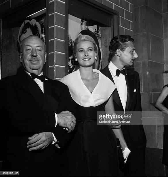 Director Alfred Hitchcock with actress Grace Kelly and Oleg Cassini at the premier of Rear Window in Los Angeles California