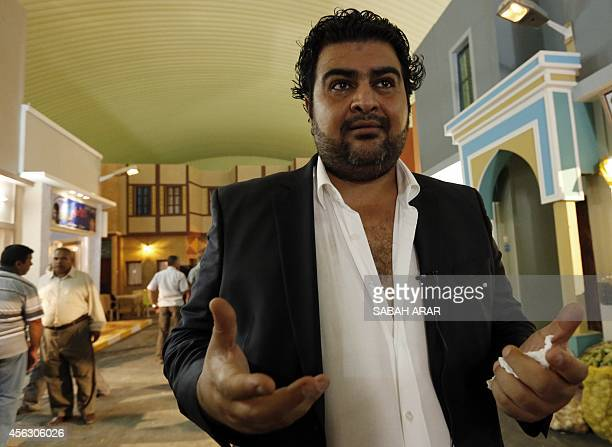 Director Ali alQassem talks to a reporter on the set of the television series whose title is loosely translated as 'State of Superstition' during...