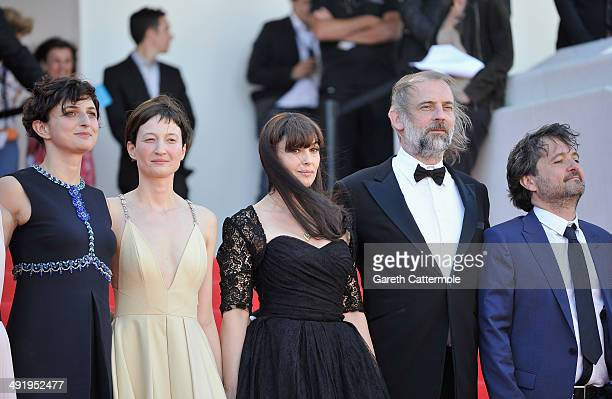Director Alice Rohrwacher actors Alba Rohrwacher Monica Bellucci Sam Louwyck and producer Carlo CrestoDina attends the La Meraviglie premiere during...