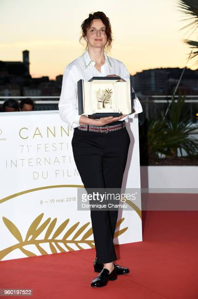Director Alice Rohrwacher poses with the Best Screenplay award for Happy As Lazzaro at the photocall the Palme D'Or Winner during the 71st annual...