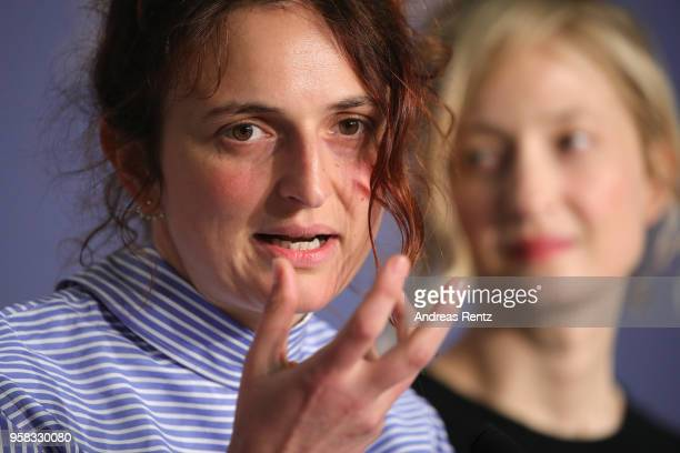 Director Alice Rohrwacher speaks as actress Alba Rohrwacher looks on at the press conference for 'Happy As Lazzaro ' during the 71st annual Cannes...