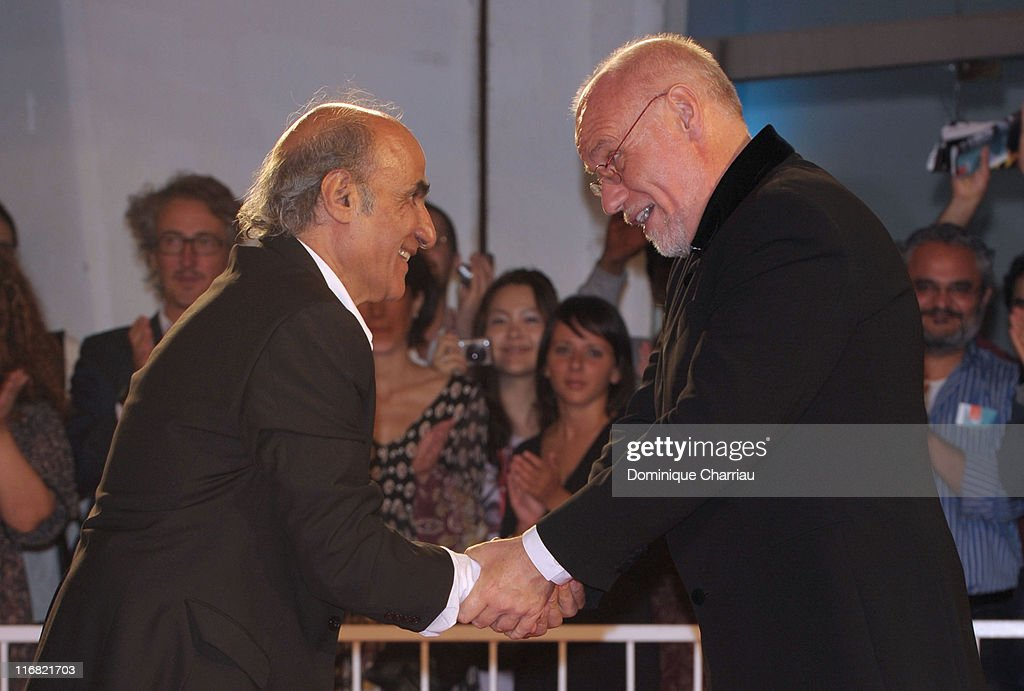 Director Amir Naderi is welcomed by Venice Festival Director Marco Mueller while attending the 'Vegas Based on a True Story' premiere at the Sala Grande during the 65th Venice Film Festival on September 1, 2008 in Venice, Italy.