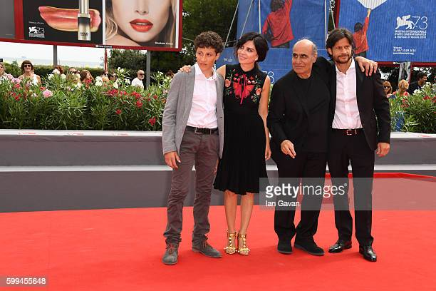 Director Amir Naderi poses with Zaccaria Zanghellini Claudia Potenza and Andrea Sartoretti during the premiere for 'Mountain' and before receiving...
