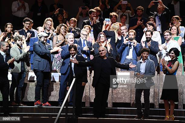 Director Amir Naderi receives the applause with Zaccaria Zanghellini Claudia Potenza and Andrea Sartoretti during the premiere for 'Mountain' and...