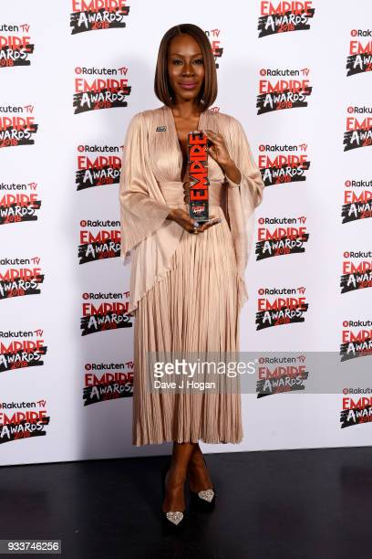 Director Amma Asante winner of the EMPIRE Inspiration award for 'A United Kingdom' poses in the winners room at the Rakuten TV EMPIRE Awards 2018 at...