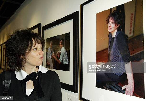 Director Amy Heckerling looks at her portrait taken by photographer Pat York at the opening night of York's photographic exhibition Imaging and...
