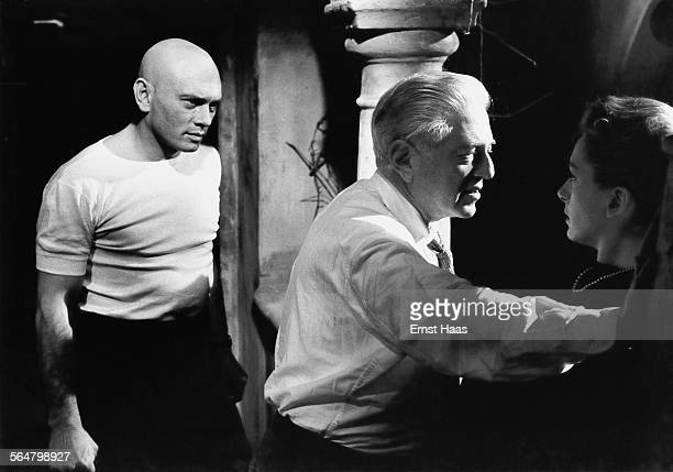 Director Anatole Litvak with actress Deborah Kerr and actor Yul Brynner on the set of the film 'The Journey' 1959