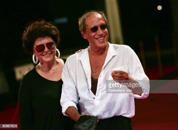 Director and actor Adriano Celentano with his wife Claudia Mori attend the 'Yuppi Du' premiere during the 65th Venice Film Festival on September 4...