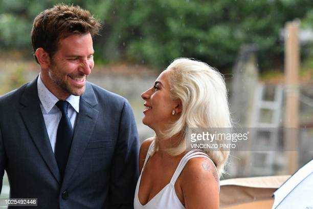 TOPSHOT Director and actor Bradley Cooper and actress Lady Gaga arrive at the Excelsior Hotel on August 31 2018 during the 75th Venice Film Festival...