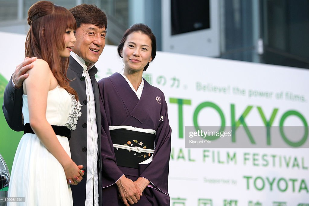 Director and actor Jackie Chan (C) poses with actresses Shoko Nakagawa (L) and Makiko Esumi during the 24th Tokyo International Film Festival (TIFF) Opening Ceremony at Roppongi Hills on October 22, 2011 in Tokyo, Japan. One of Asia's largest film festivals takes place from October 22 to 30, showcasing about 130 highly-selected films from a variety of genres in several programs including the 'Competition' section for the Tokyo Sakura Grand Prix.