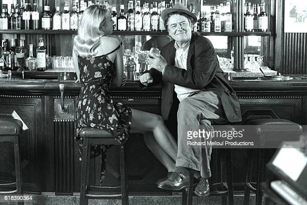 Director and Actor JeanPierre Mocky in a Parisian Cafe with Woman