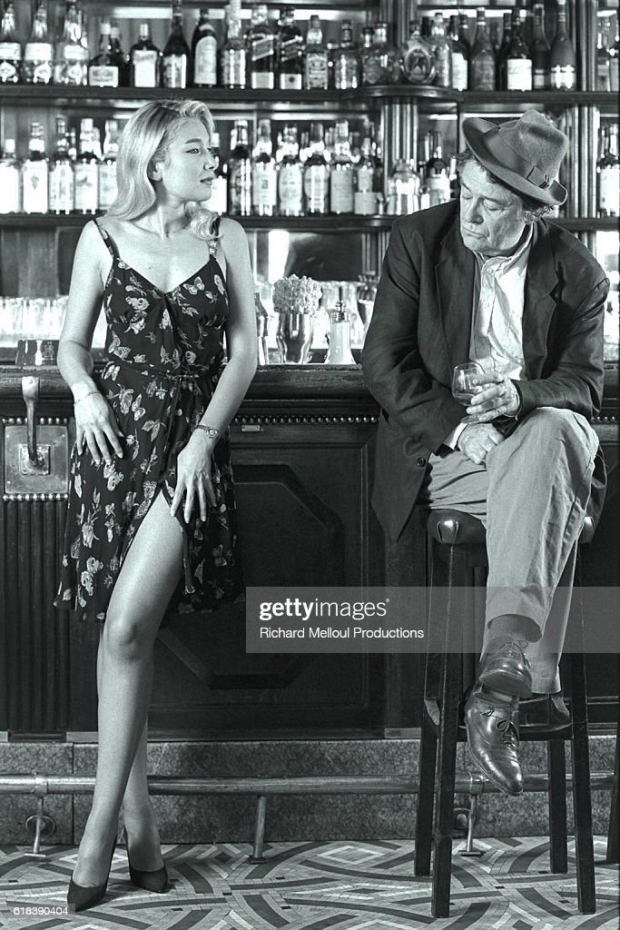 Director and Actor Jean-Pierre Mocky in a Parisian Cafe with Young Actress : Photo d'actualité