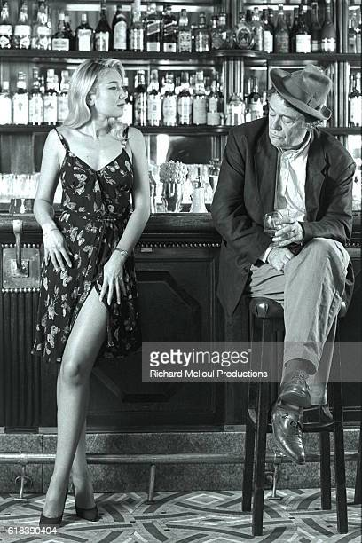 Director and Actor JeanPierre Mocky in a Parisian Cafe with Young Actress