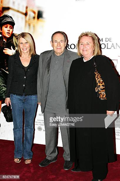 """Director and actor Robert Hossein with his wife Candice Patou attend the premiere of """"Oliver Twist"""" in Paris."""