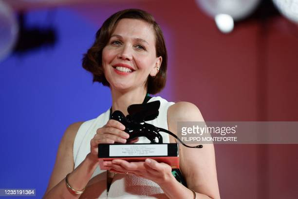 """Director and actress Maggie Gyllenhaal poses with the Award for Best Screenplay she received for """"The Lost Daughter"""" during the Winners' Photocall..."""