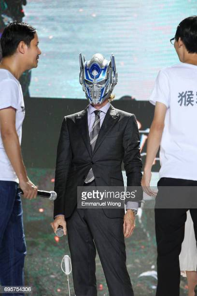 Director and Executive Producer Michael Bay wears a Transformer mask during the 'Transformers The Last Knight' China World Premiere and Ten Year...