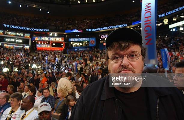 Director and film maker Michael Moore arrives at the Michigan delegation section during the Democratic National Convention Michigan is his home state