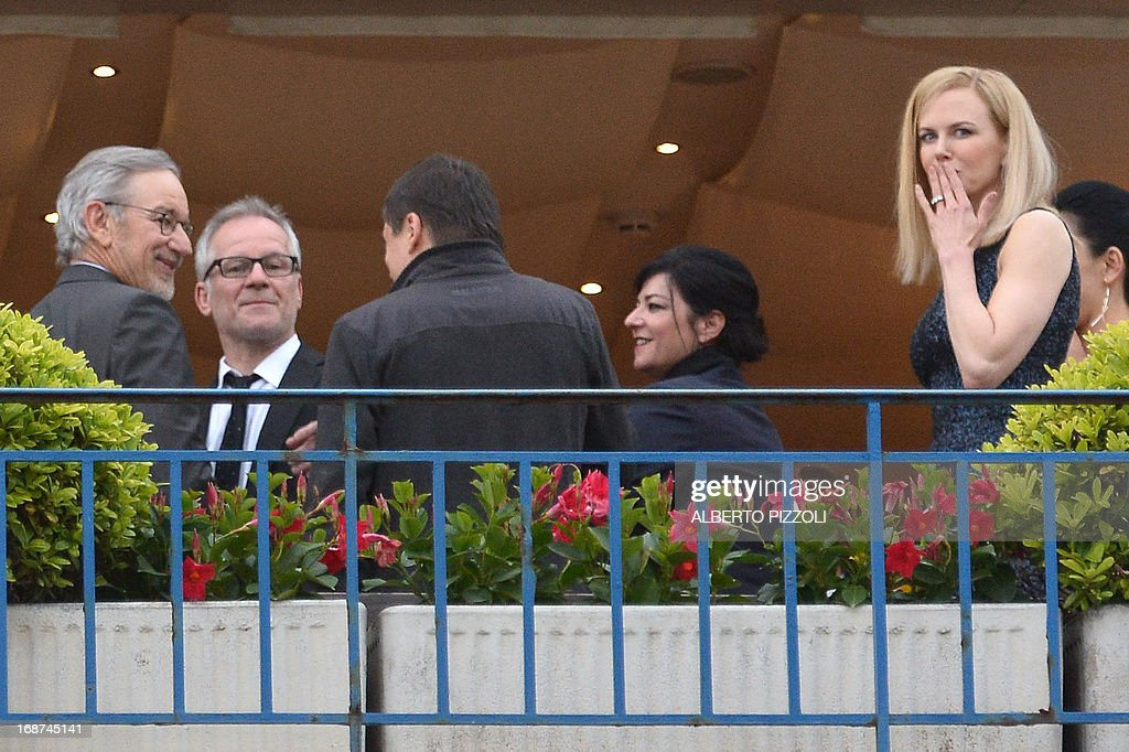 US director and President of the Feature Film Jury, Steven Spielberg, General Delegate of the Cannes Film Festival Thierry Fremaux, and Feature Film Jury members Romanian director Cristian Mungiu, British director Lynne Ramsay, Australian actress Nicole Kidman and Japanese director Naomi Kawase pose on May 14, 2013 on the balcony of the Grand-Hyatt Martinez Hotel in Cannes on the eve of the 66th edition of the Cannes Film Festival. Cannes, one of the world's top film festivals, opens on May 15 and will climax on May 26 with awards selected by a jury headed this year by Hollywood legend Steven Spielberg.