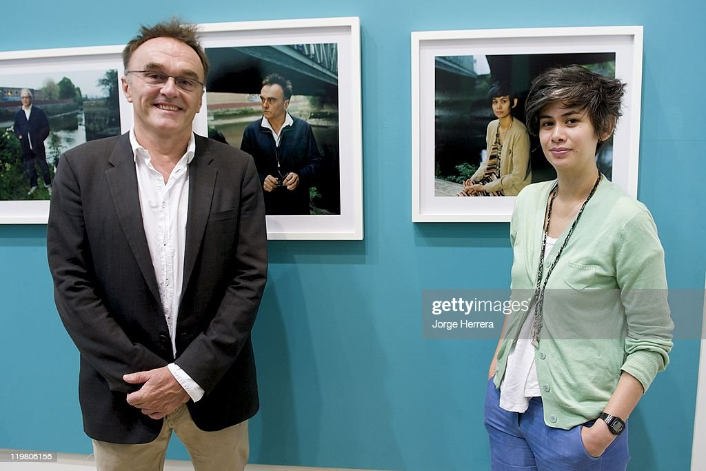 Director and Producer Danny Boyle and Film and Theatre Designer Suttira Larlarb pose by their portraits during 'Road to 2012: Changing Pace,' the unveiling of new portraits of the people making London 2012 happen, at the National Portrait Gallery on July 25, 2011 in London, England.