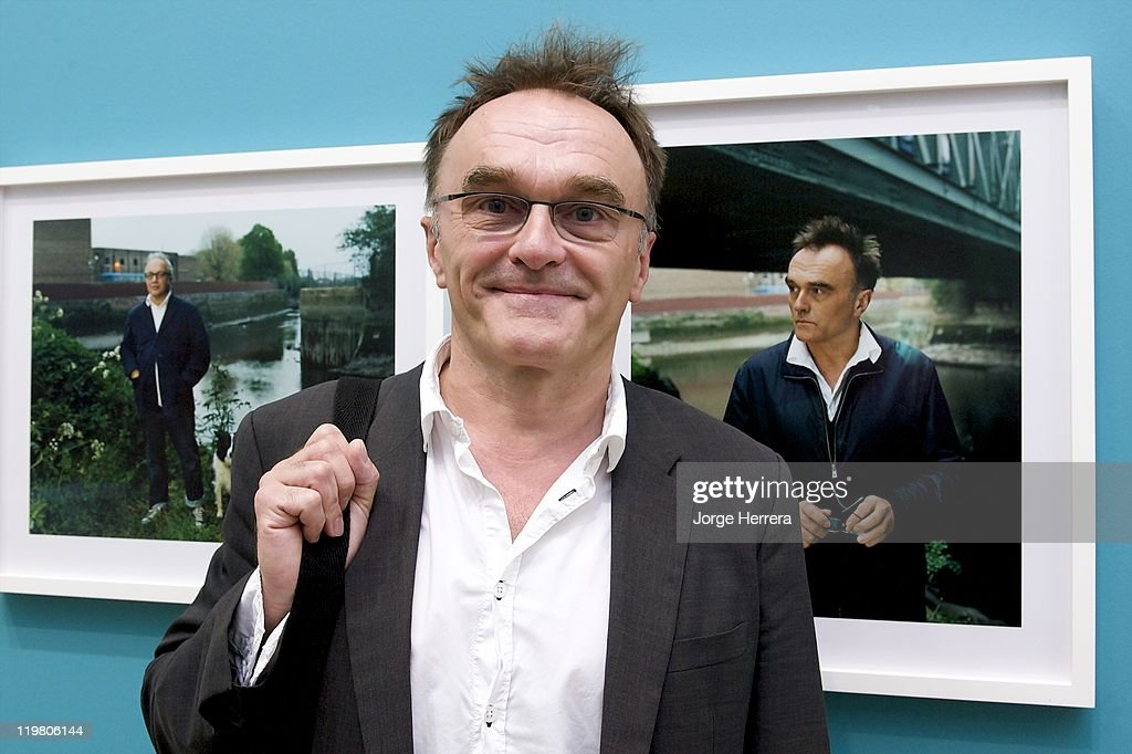 Director and Producer Danny Boyle poses by his portrait during 'Road to 2012: Changing Pace,' the unveiling of new portraits of the people making London 2012 happen, at the National Portrait Gallery on July 25, 2011 in London, England.