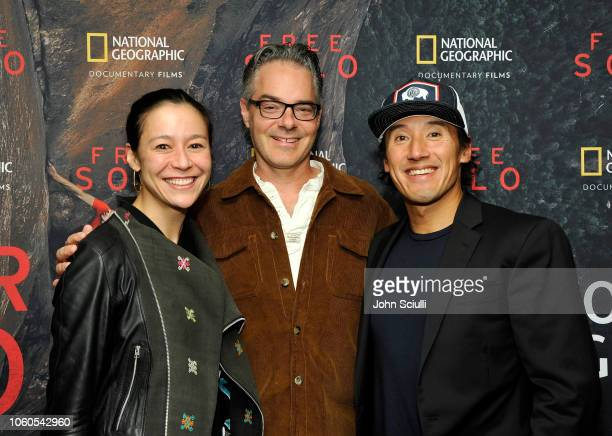 Director and producer Elizabeth Chai Vasarhelyi composer Marco Beltrami and director producer and cinematographer Jimmy Chin attend the screening of...