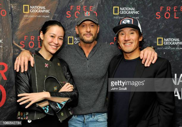 Director and producer Elizabeth Chai Vasarhelyi Tim McGraw and director producer and cinematographer Jimmy Chin attend the screening of Free Solo...