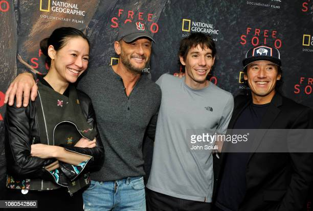 Director and producer Elizabeth Chai Vasarhelyi Tim McGraw featured climber Alex Honnold and director producer and cinematographer Jimmy Chin attend...