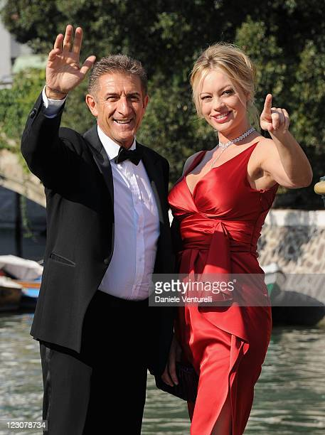 Director and producer Ezio Greggio and actress Anna Falchi arrive for the 'Box Office 3D' premiere during the 68th Venice Film Festival on August 30...