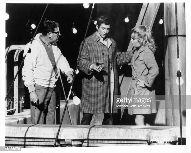 Director and producer Mark Robson shows Scott Hylands and Carol White how he wants the scene to be played for the film 'Daddy's Gone AHunting' 1969