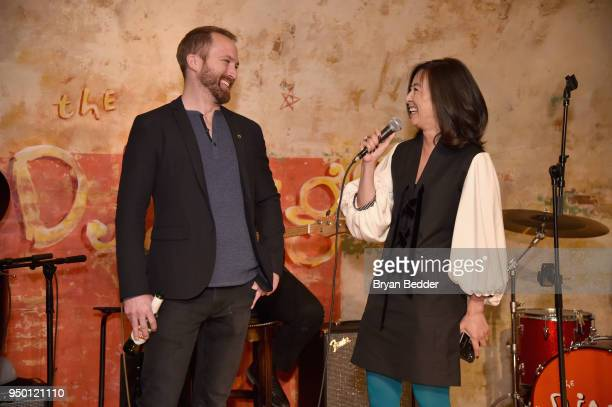 Director and Producer Neil Gelinas and Executive Producer Clara Wu Tsai speak onstage during the National Geographic 'Into the Okavango' after party...
