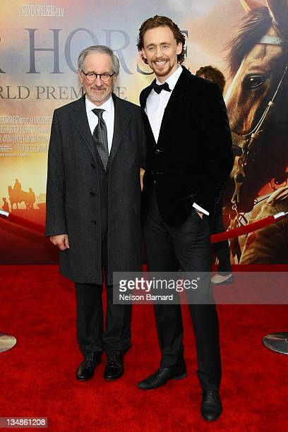Director and producer Steven Spielberg and actor Tom Hiddleston attend the War Horse world premiere at Avery Fisher Hall at Lincoln Center for the...