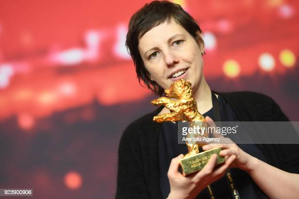 Director and screenwriter Adina Pintilie holds the golden bear for the best movie for her film 'Touch me not' at a news conference during the 68th...