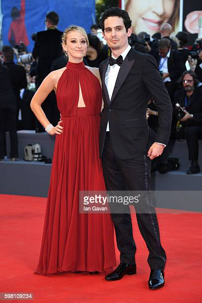 Director and screenwriter Damien Chazelle wearing a JaegerLeCoultre watch and Olivia Hamilton attend the opening ceremony and premiere of 'La La...