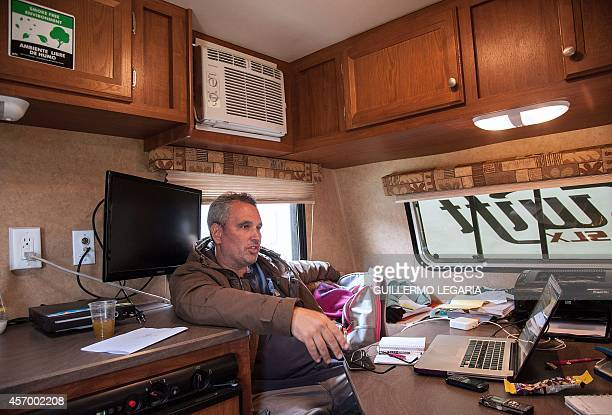 US director and writer Ken Sanzel speaks during an interview with AFP as he takes a break from shooting the movie Blunt Force Trauma on October 8...