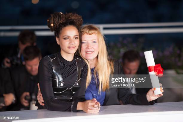 Director Andrea Arnold celebrates with Sasha Lane after being awarded the Jury Prize for the film 'American Honey' during the Palme D'Or Winner...