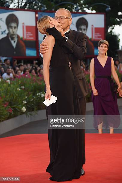 Director Andrei Konchalovsky and wife Julia Vysotskaya attend the Closing Ceremony during the 71st Venice Film Festival at Sala Grande on September 6...