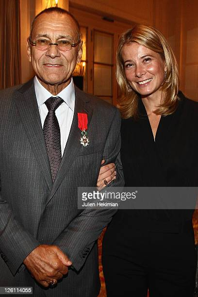 Director Andrei Konchalovsky is pictured with his wife Yuliya Vysotskaya after being awarded Chevalier de la Legion d'Honneur at Hotel Bristol on...