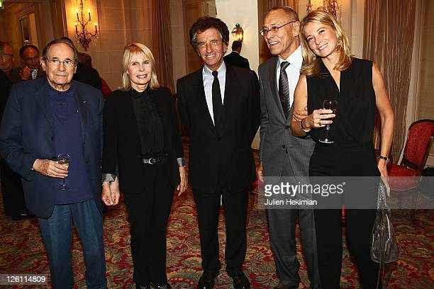 Director Andrei Konchalovsky is pictured with his wife Yuliya Vysotskaya Robert Hossein and his wife Candice Patou and Jack Lang after being awarded...