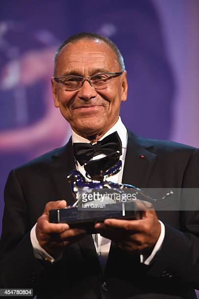 Director Andrei Konchalovsky poses with the Silver Lion Award for 'The Postman's White Knights' on stage during the Closing Ceremony of the 71st...