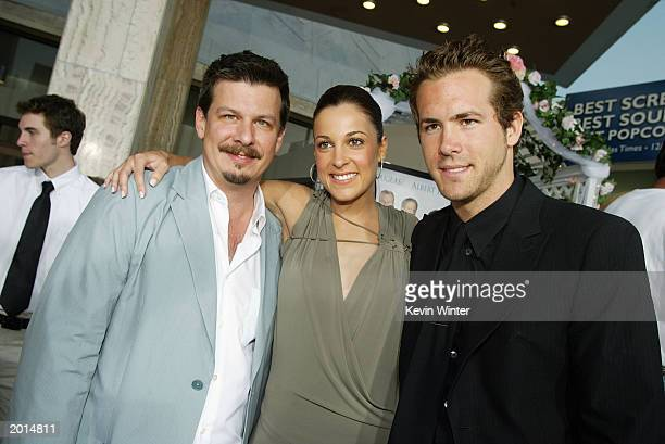 Director Andrew Fleming actress Lindsay Sloane and actor Ryan Reynolds arrive at the premiere of The InLaws at the Cinerama Dome May 19 2003 in Los...