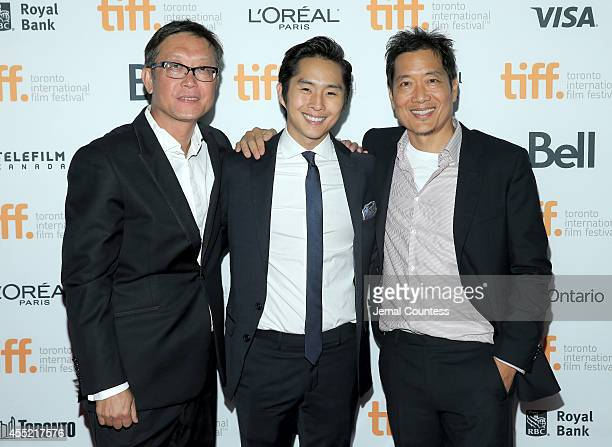 Director Andrew Lau actor Justin Chon and director Andrew Loo attend the Revenge Of The Green Dragons premiere during the 2014 Toronto International...