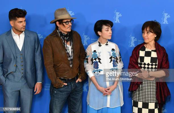 Director Andrew Levitas Johnny Depp Minami and writer Aileen Mioko Smith attend the Minamata photo call during the 70th Berlinale International Film...
