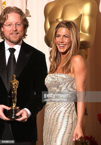 Director Andrew Stanton poses with his Best Animated Feature Film award for WallE in the press room together with Actress Jennifer Aniston at the...