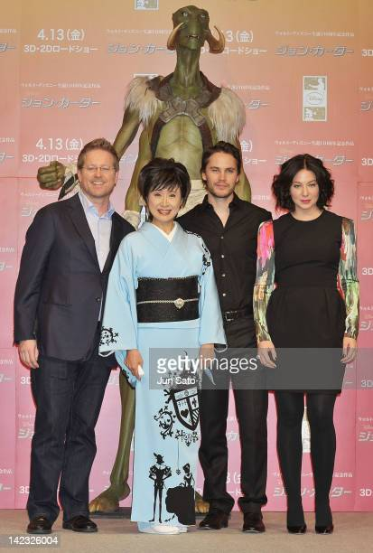 Director Andrew Stanton singer Sachiko Kobayashi actor Taylor Kitsch and actress Lynn Collins attend the 'John Carter' Press Conference at the Ritz...