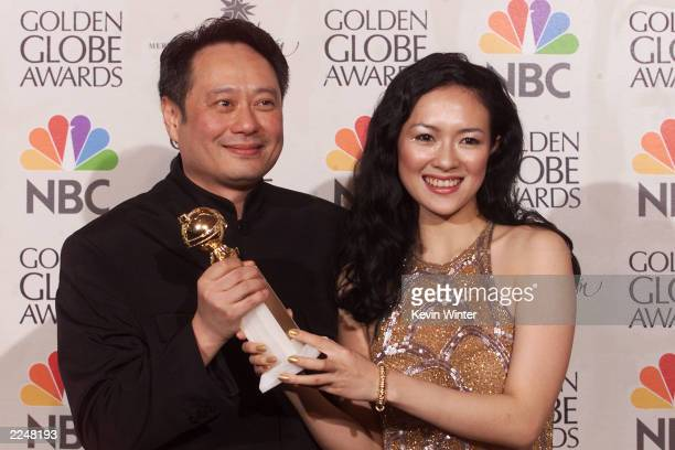 Director Ang Lee and Actress Zhang Ziyi with the award for Best DirectorMotion Picture for 'Crouching Tiger Hidden Dragon' at the 58th Annual Golden...