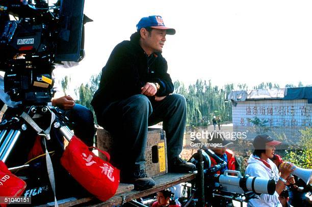 Director Ang Lee Goes Over A Scene On The Set Of Crouching Tiger Hidden Dragon