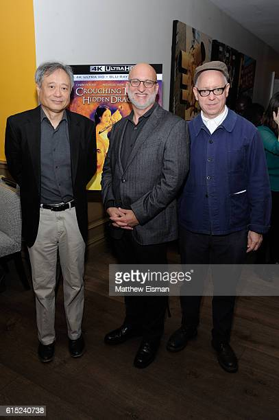 Director Ang Lee moderator Joe Neumaier and screenwriter James Schamus pose together for a photo at the Crouching Tiger Hidden Dragon Screening and...